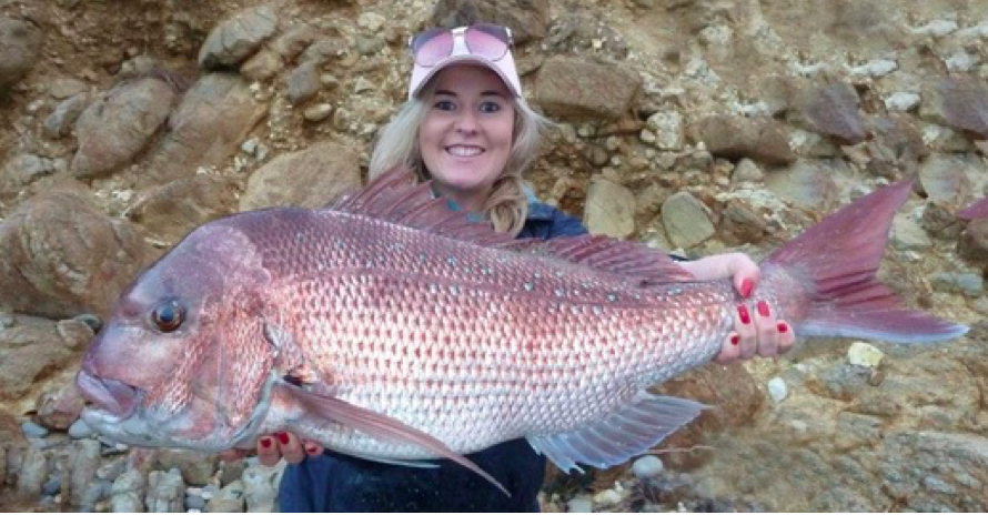 A lady holding a very, very, very large snapper