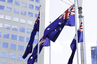 Image of Australian flags outside building