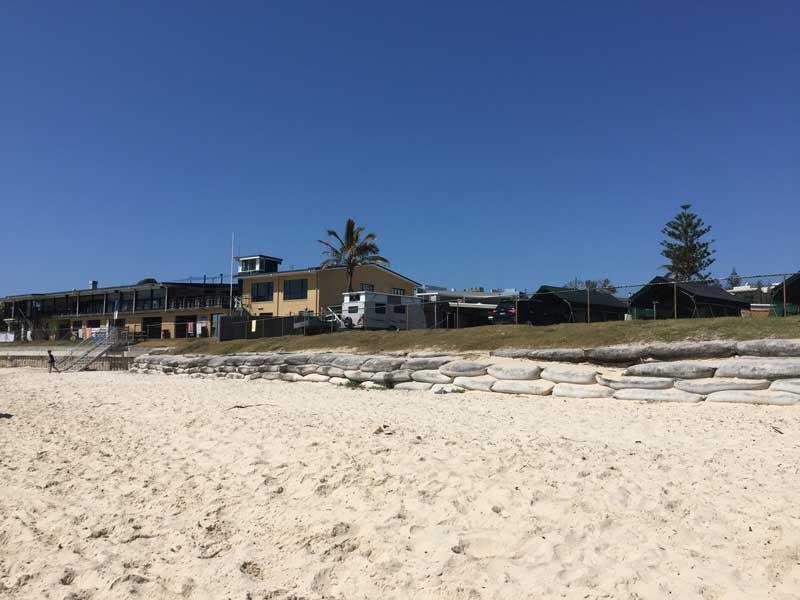 A seawall produced from sandbags to protect council caravan park from erosion, Kingscliff NSW