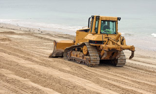 dozer on beach