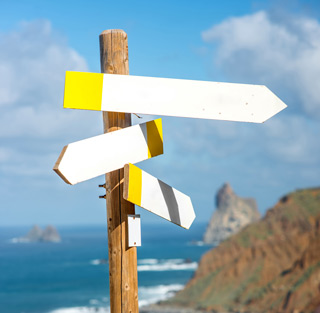 signposts on beach