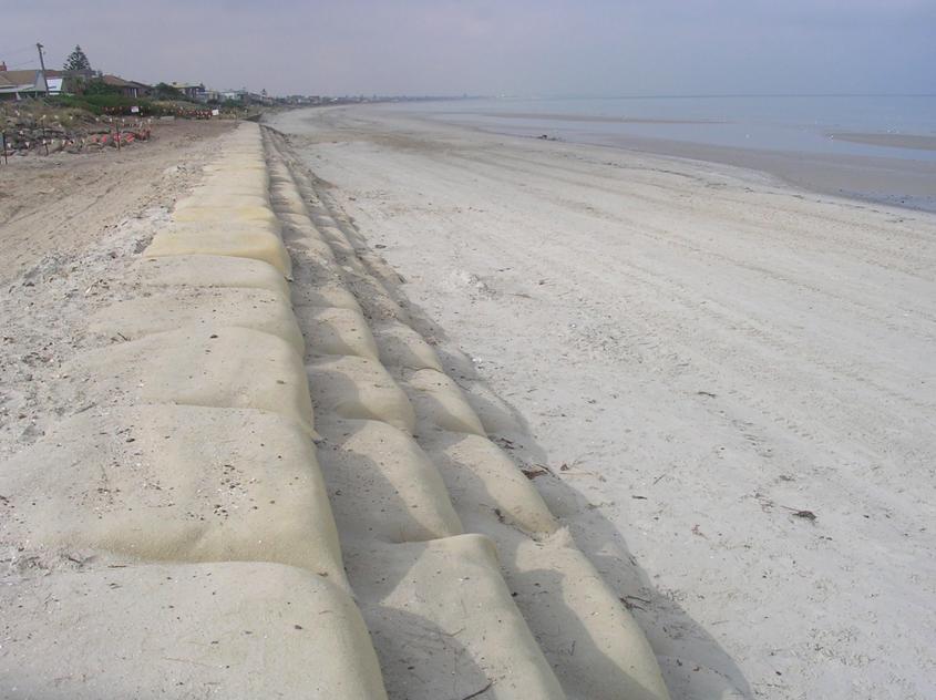 Geotextile sandbags protecting a beach